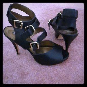 Peek-a-boo black Gladiator shoes.